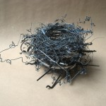 "typewriter parts and wire 10"" x10"" x 7"""