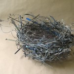"wire hangers,bicycle spokes,springs , typewriter parts, etc 23"" x15"" x 7"""