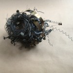 "7"" x 9"" x 12"" typewriter parts and wire"